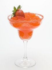 Frozen Strawberry Daiquiri in glass with fresh strawberry