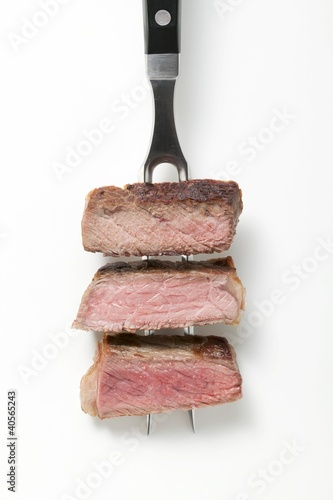 Rump steak cooked to different degrees (rare, medium, well done)