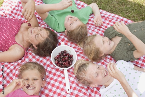 Children eating cherries