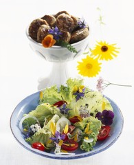 Mixed salad with edible flowers, burgers