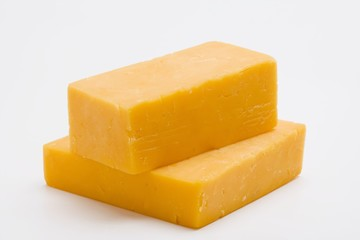 Two pieces of Cheddar cheese