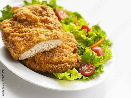 Breaded chicken breast with salad