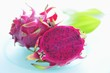 Pink-fleshed dragon fruit, whole fruit and a half
