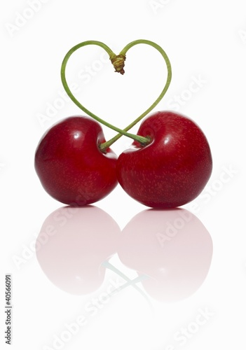 Pair of cherries forming a heart