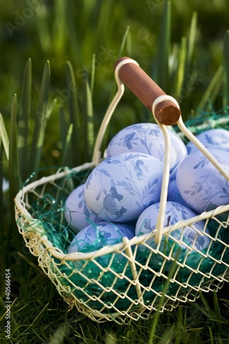 Blue Easter eggs in wire basket