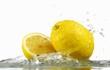 Lemons with splashing water