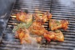 Chicken wings with rosemary on smoking barbecue