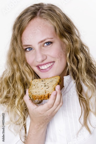 Young woman with a slice of grannary bread