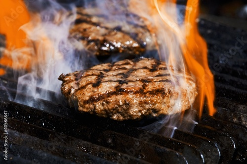 Flame grilled burgers on the grill
