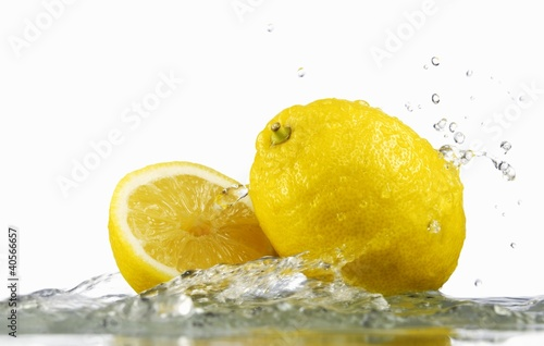 Lemons with splashing water
