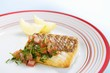 Fried snapper fillet with tomato salsa