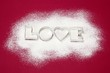 Biscuits cutters for 'LOVE' biscuits on icing sugar
