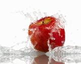 Red apple with splashing water
