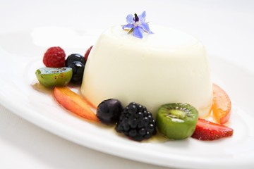 Buttermilk pudding surrounded by fruit