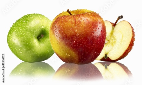 Fresh apples (green, red & yellow) with drops of water & reflection
