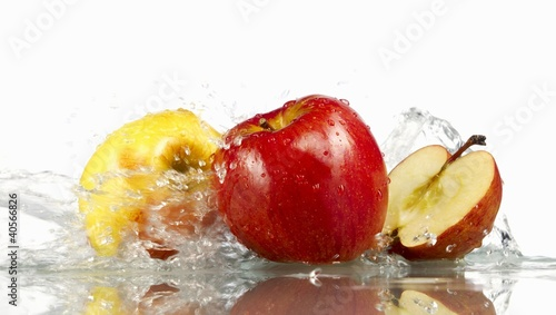 Red and yellow apples with splashing water