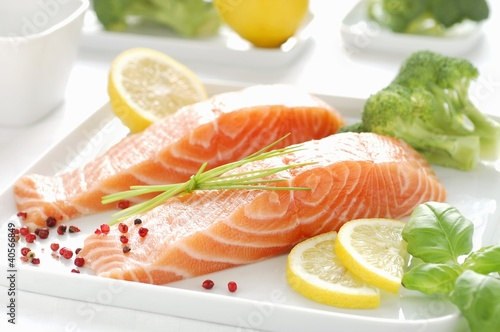 Raw salmon fillet, lemon slices, basil and broccoli
