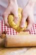 Hands kneading biscuit dough