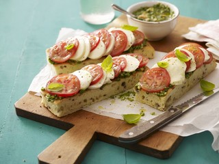 Focaccia topped with pesto, tomatoes and mozzarella