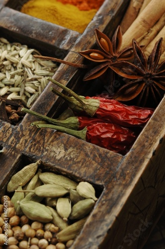 Assorted spices in wooden box (close-up)