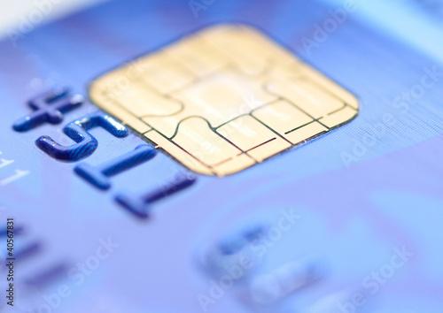 Closeup image of old blue credit card.