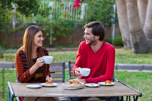 Happy smiling couple having lunch