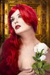 Gothic woman with white rose in her hand, gold ornament backgrou
