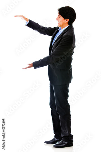 Businessman holding something