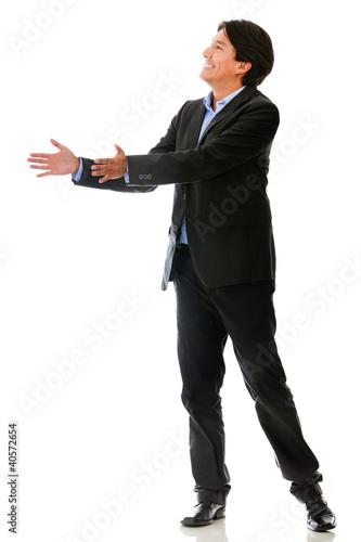 Businessman passing an object