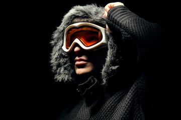 Snowboarder fashion portrait on black