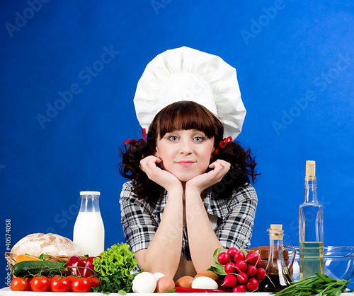 Smiling happy cook woman with food ingredients