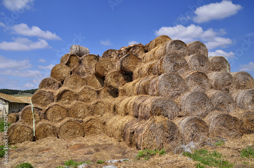 Agricultural landscape: Bales of hay in foreground