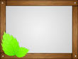 Wooden frame with green leaves. Vector illustration.