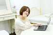 Beautiful young woman using a laptop computer
