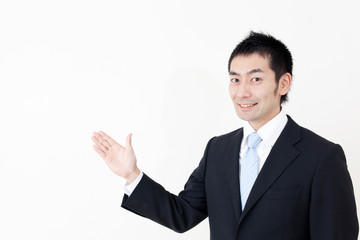 a portrait of asian businessman showing