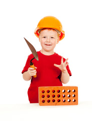 Builder boy or kid in red tshirt and hard hat. Construction conc