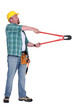 Man using bolt cutter