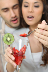 Couple with a glass of strawberry