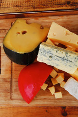 delicious cheeses on wood