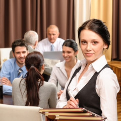 Waitress hold menu business people at restaurant