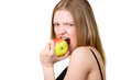 Beautiful young woman with brackets on teeth eating the apple