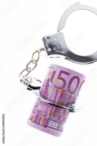 Wirtschaftskriminalität. handschellen und Euro