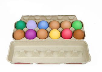 carton of colorful eggs on a white background
