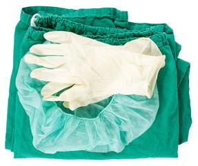Grüne Operationskleidung mit Haube und Handschuhen
