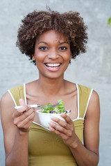 pretty African American woman with salad