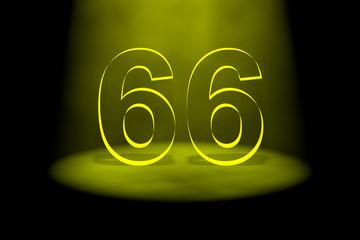 Number 66 illuminated with yellow light