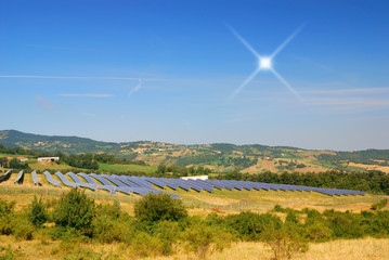 solar panels in countryside under blu sky
