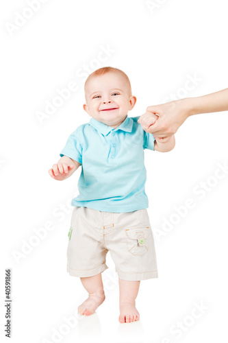 smiling child walking hand in hand with mom