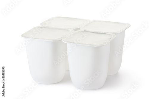 Four plastic container for dairy products with foil lid