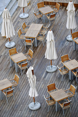 Teak tables and chairs on timber decking